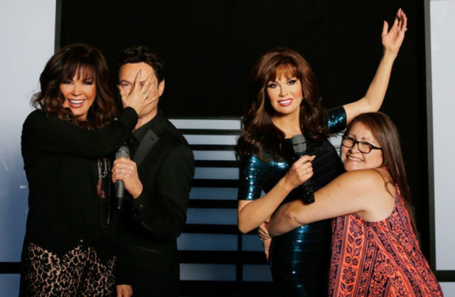 Marie Osmond, left, playfully covering the wax figure face of her brother, Donny Osmond, meets fans at Madam Tussauds (Isaak Brekken/Getty Images for Madame Tussauds)