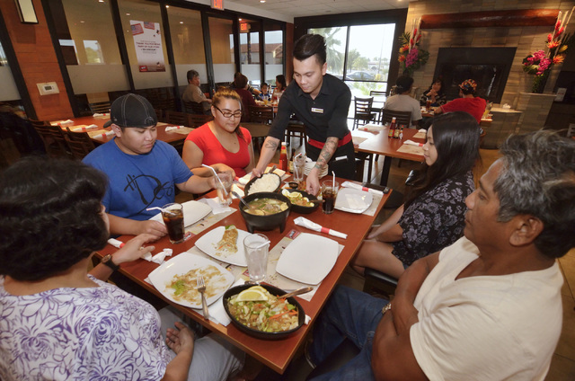 Roy Cabulang serves customers at Max's Restaurant at 1290 E. Flamingo Road on Saturday, Aug. 27, 2016. (Bill Hughes/Las Vegas Review-Journal)