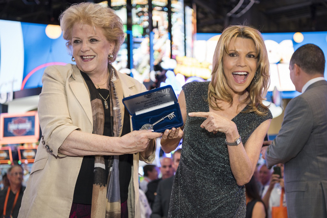 "Mayor Carolyn Goodman, left, gives a key to the city to Vanna White for 20 years of ""Wheel of Fortune"" slots. (Courtesy IGT)"
