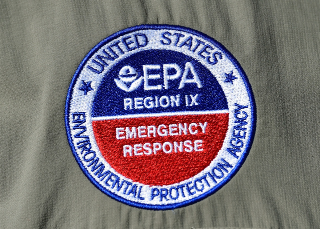 A logo for the Environmental Protection Agency emergency response is seen at a news conference at Walter Johnson Junior High School Monday, Sept. 12, 2016, in Las Vegas. The school is scheduled to ...
