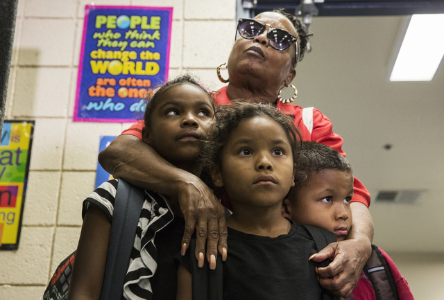 Denise Allen, middle, with Monica, Juliana and Ernesto Brown, listens to a briefing during a town hall meeting at Jacobson Elementary School on Thursday, Sept. 8, 2016, in Las Vegas. The Clark Cou ...