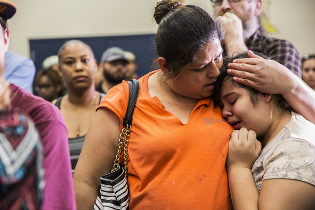 Janet Anaya, left, consoles daughter Lluvia, a 6th grader at  Johnson Junior High School, during a town hall meeting at Jacobson Elementary School on Thursday, Sept. 8, 2016, in Las Vegas. The Cla ...