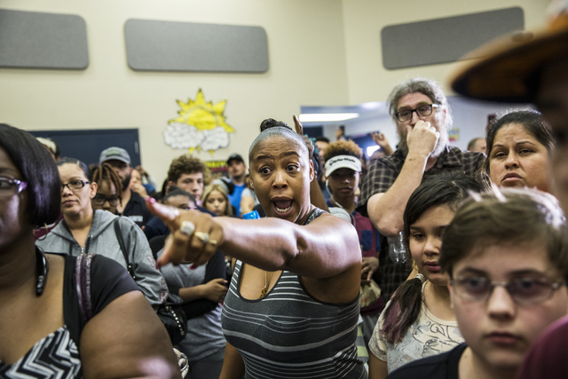 Nicole Watson, middle, screams at an Environmental Protection Agency official during a town hall meeting at Jacobson Elementary School on Thursday, Sept. 8, 2016, in Las Vegas. The Clark County Sc ...