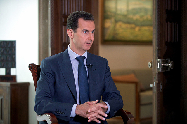 """Syrian President Bashar Assad said U.S. airstrikes on Syrian troops in the country's east were """"definitely intentional,"""" lasting for an hour. (Syrian Presidency via AP)"""