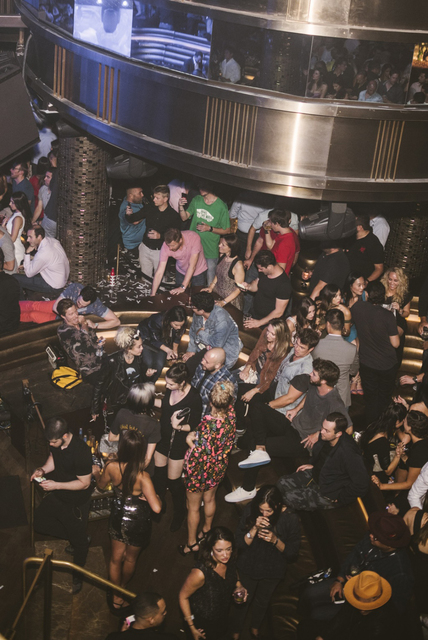 Miley Cyrus and Liam Hemsworth party Friday at Omnia. (Courtesy)