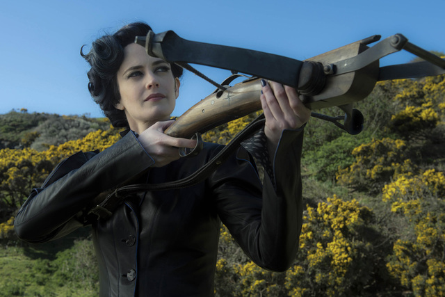 DF-07237 - Miss Peregrine (Eva Green) takes aim at her powerful enemies. Photo Credit: Jay Maidment.