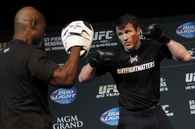 Fighter Chael Sonnen, right, spars during a media workout session for UFC 163 in the Hollywood Theater at the MGM Grand in Las Vegas on Nov. 13, 2013. (Jason Bean /Las Vegas Review-Journal File)