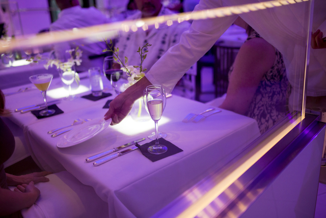 A server sets fresh plates for guests at Mr. Chow at Caesars Palace in Las Vegas, Saturday, Sept. 17, 2016. (Elizabeth Page Brumley/Las Vegas Review-Journal Follow @elipagephoto)