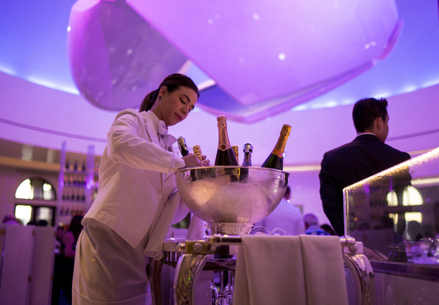 A server prepares to pour champagne from the champagne trolley at Mr. Chow at Caesars Palace in Las Vegas, Saturday, Sept. 17, 2016. (Elizabeth Page Brumley/Las Vegas Review-Journal Follow @elipag ...