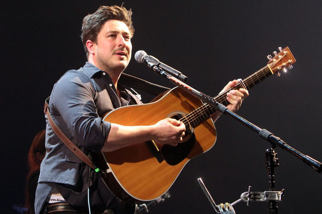 Marcus Mumford with Mumford & Sons perform at the Infinite Energy Arena on Monday, April 11, 2016, in Atlanta. (Katie Darby/Invision/AP)