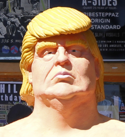 In this Aug. 18, 2016 photo, a statue of presidential hopeful Donald Trump is placed outside a shop in the Hollywood section of Los Angeles.  (AP Photo/Delara Shakib)