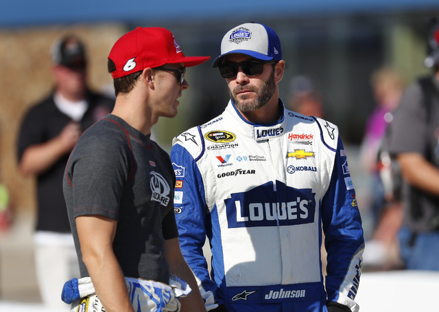 Trevor Bayne, left, talks with Jimmie Johnson before qualifications for the NASCAR Sprint Cup Series auto race at Michigan International Speedway. Johnson is ranked first for Teenage Mutant Ninja  ...