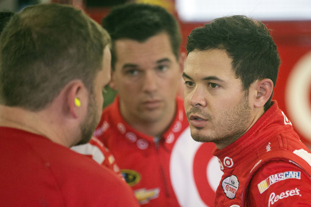 Kyle Larson talks with his crew after posting the fastest time during practice for Sunday's NASCAR Sprint Cup Series auto race at New Hampshire Motor Speedway Friday, Sept. 23, 2016, in Loudon, N. ...