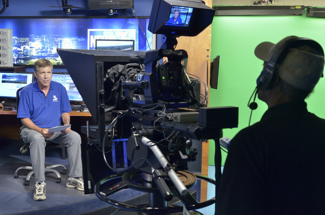 Tom Hawley, a traffic, transportation and local history reporter at KSNV-TV, Channel 3, left, goes on air at the station at 1500 Foremaster Lane in Las Vegas as Warren Spears operates the camera o ...