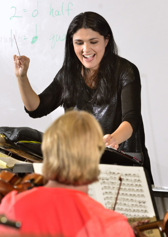 Alexandra Arrieche, the Henderson Symphony Orchestra's new music director, bonds with the orchestra's volunteer musicians during a recent rehearsal at Greenspun Junior High School. Bill Hughes/Las ...