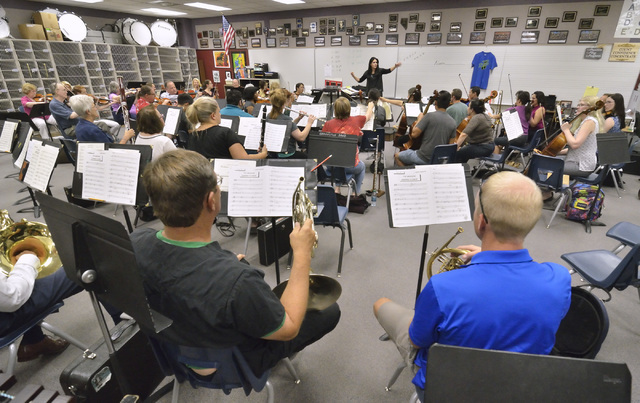 Members of the Henderson Symphony Orchestra gather at Greenspun Junior High to rehearse with new music director Alexandra Arrieche, who'll conduct Friday's free concert at the Henderson Pavilion.  ...