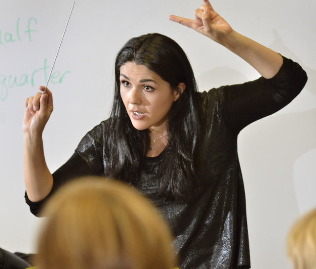 Alexandra Arrieche, the Henderson Symphony Orchestra's new music director, rehearses the ensemble in preparation