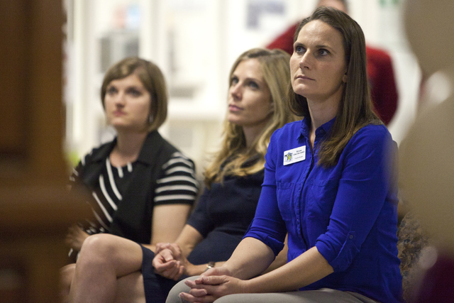 Project 150 program manager Brooke Allen-Burnstein, from right, Leah Miller and Dana Deluce from The Cosmopolitan of Las Vegas attend the grand opening ceremony of the new student center at Desert ...