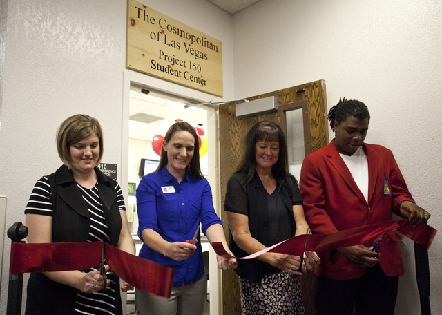 From left, Leah Miller, Brooke Allen-Burnstein, Dr. Tammy Malich and Charles Blackwell cut the ribbon during the grand opening of the new student center at Desert Rose High School in North Las Veg ...