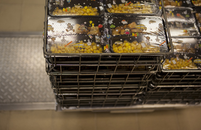Individually wrapped meals are shown stacked and prepared at the Clark County School District Food Service facility in Las Vegas Sept. 9. Miranda Alam/View