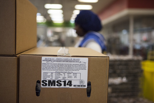 An employee packs up boxes of spaghetti at the Clark County School District Food Service facility in Las Vegas Sept. 9. Miranda Alam/View
