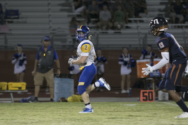 Moapa Valley's Jacob Leavitt (2) runs for a touchdown against Legacy High during a varsity football game at Legacy High School on Friday, Sept. 9, 2016. Richard Brian/Las Vegas Review-Journ ...