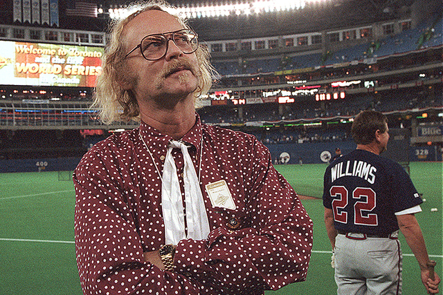 Canadian author W.P. Kinsella stands on the field before Game 5 of the World Series between Toronto Blue Jays and Atlanta Braves  in Toronto, Ontario. Kinsella has died at 81. (The Associated Pres ...