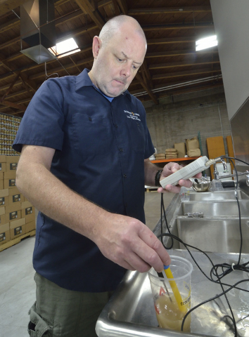 Head brewer Anthony Gibson checks the pH level of a mash during a brew at Tenaya Creek Brewery at 831 W. Bonanza Road on Friday, Sept. 9, 2016. (Bill Hughes/Las Vegas Review-Journal)