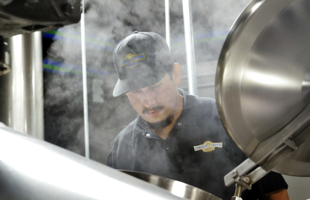 Steam rises from a vat as assistant brewer Marcos Lopez checks on mash being transferred to a brew kettle at Tenaya Creek Brewery at 831 W. Bonanza Road on Friday, Sept. 9, 2016. (Bill Hughes/Las  ...