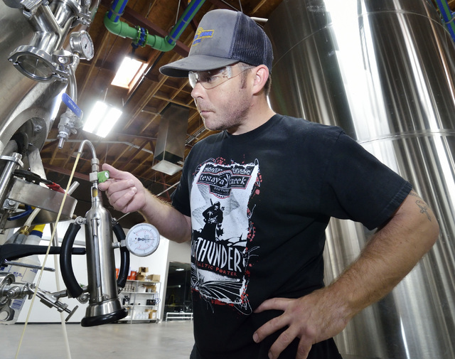 Assistant brewer Johnny Moroney prepares to check the carbonation level on a beer at Tenaya Creek Brewery at 831 W. Bonanza Road on Friday, Sept. 9, 2016. (Bill Hughes/Las Vegas Review-Journal)