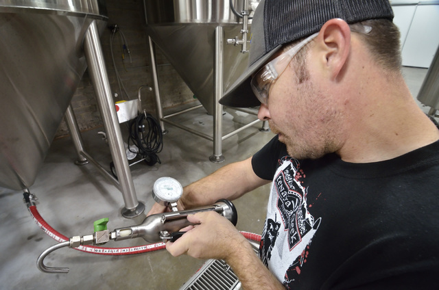 Assistant brewer Johnny Moroney checks the carbonation level on a beer at Tenaya Creek Brewery at 831 W. Bonanza Road on Friday, Sept. 9, 2016. (Bill Hughes/Las Vegas Review-Journal)
