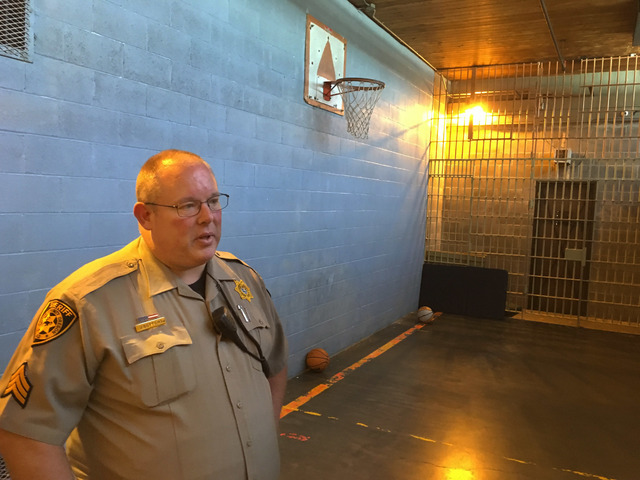 Crook County Sheriff Sgt. Jeremy Bottoms stands inside the recreation room at the Crook County Jail in Prineville, Ore., on July 1, 2016.  (Andrew Selsky/The Associated Press)