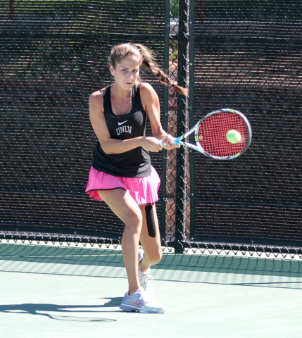 Women's UNLV tennis player Jovana Kenic connects with the ball during a singles match at the Frank and Vicki Fertitta Tennis Complex on the UNLV campus in Las Vegas, Saturday, Sept. 24, 2016. (Don ...