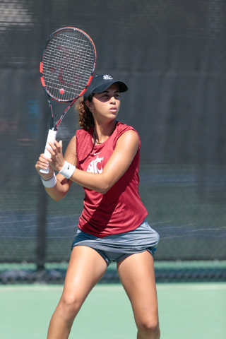 Washington State Cougars women's tennis player Ege Tomey waits to return a serve by UNLV tennis player Jovana Kenic  during a singles match at the Frank and Vicki Fertitta Tennis Complex on the UN ...