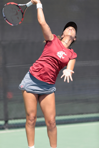 Washington State Cougars women's tennis player Ege Tomey serves the ball to UNLV tennis player Jovana Kenic  during a singles match at the Frank and Vicki Fertitta Tennis Complex on the UNLV campu ...