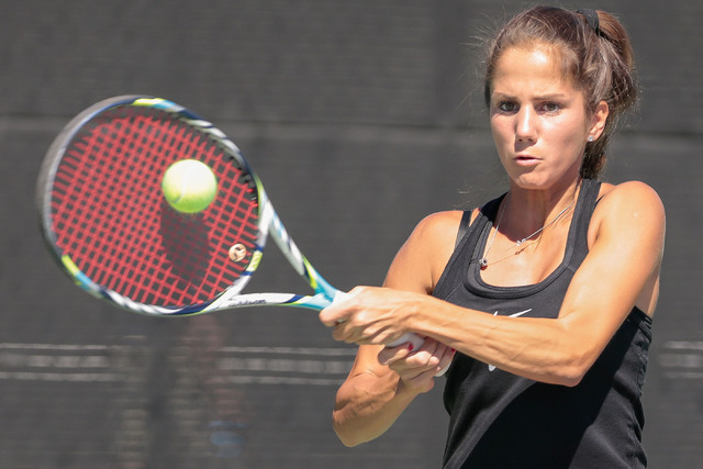 Women's UNLV tennis player Jovana Kenic makes a back hand swing during a singles match at the Frank and Vicki Fertitta Tennis Complex on the UNLV campus in Las Vegas, Saturday, Sept. 24, 2016. (Do ...