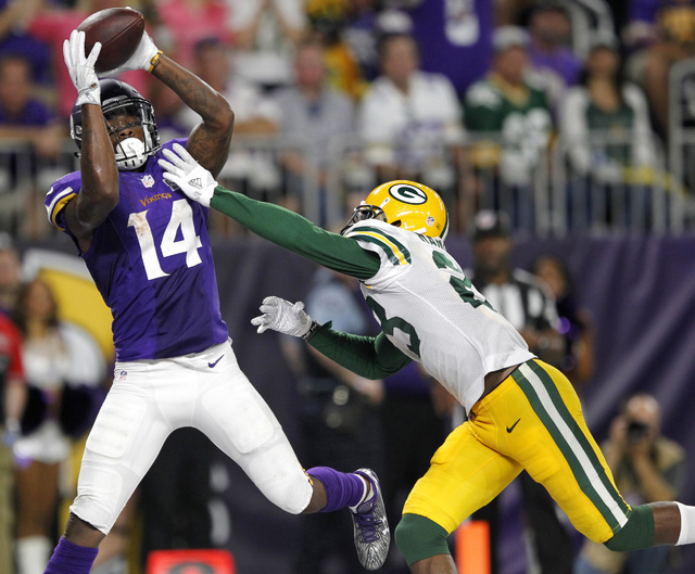 Minnesota wide receiver Stefon Diggs catches a 25-yard touchdown pass over Green Bay cornerback Damarious Randall during the second half Sunday, Sept. 18, 2016, in Minneapolis. (Andy Clayton-King/ ...