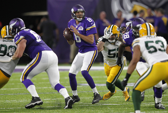 Minnesota quarterback Sam Bradford throws a pass during the first half against the Green Bay Packers, Sunday, Sept. 18, 2016, in Minneapolis. (Andy Clayton-King/The Associated Press)