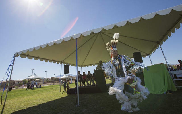 Benny Tso, 18, of the Las Vegas Paiute Tribe, performs a traditional grass dance during the grand opening celebration of the new Paiute Park in the Mountainճ Edge community in southwest Las  ...