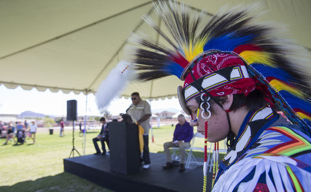Benny Tso, 18, of the Las Vegas Paiute Tribe, bows his head as his father performs a traditional blessing during the grand opening celebration of the new Paiute Park in the Mountainճ Edge co ...