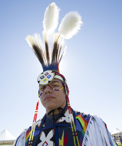 Benny Tso, 18, of the Las Vegas Paiute Tribe, poses after performing a traditional grass dance during the grand opening celebration of the new Paiute Park in the Mountainճ Edge community in  ...