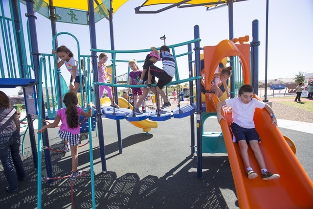 Youth play on a jungle gym during the grand opening celebration of the new Paiute Park in the Mountainճ Edge community in southwest Las Vegas on Saturday, Sept. 17, 2016. Richard Brian/Las V ...
