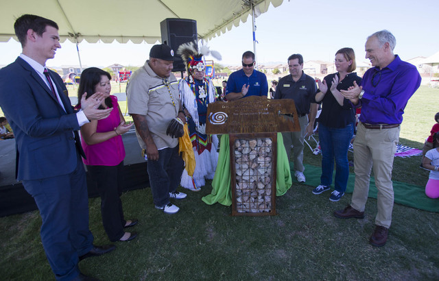 Dignitaries and guest unveil the plaque for the new Paiute Park during the grand opening celebration of the park in the Mountainճ Edge community in southwest Las Vegas on Saturday, Sept. 17, ...