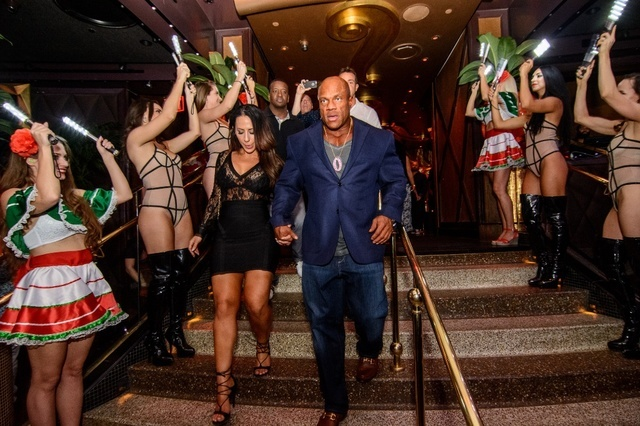 Phil Heath arrives at XS nightclub after winning his sixth Mr. Olympia title. (Karl Larson)