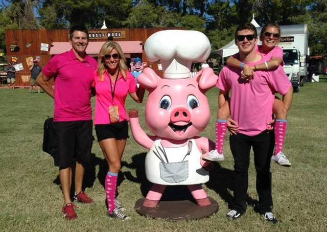 The Radwanski family is seen at the inaugural Pigs for the Kids event in 2015: from left, Todd Radwanski, founder and Adilyn's father; Shawn Radwanski, Adilyn's mother, with Sir Admiral Piggin ...