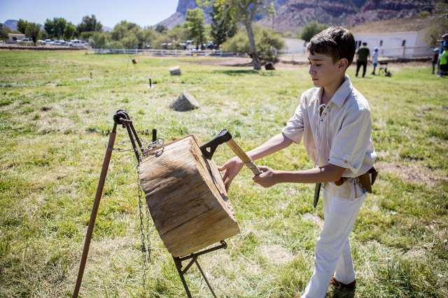 """Puddle Jumper"", 13,  retrieves a hatchet he throws into a block of wood during Pioneer Day at Spring Mountain Ranch State Park in Las Vegas, Sat, Sept. 17, 2016. Elizabeth Page  ..."