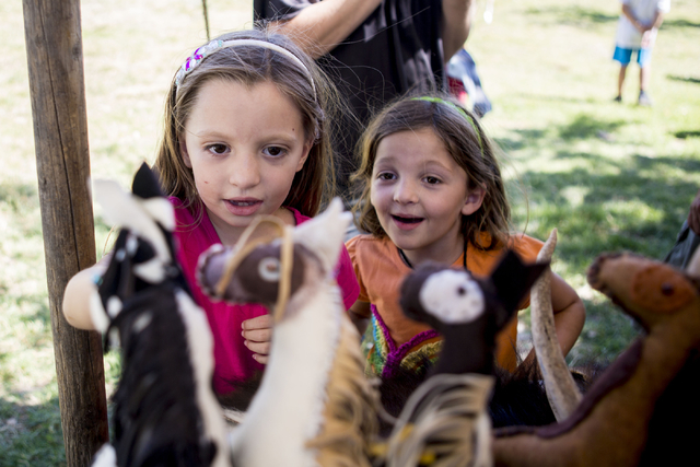 Twins Natalie Balls, 6, left, and Melanie Balls awe over handmade stuffed animal horses during Pioneer Day at Spring Mountain Ranch State Park in Las Vegas, Sat, Sept. 17, 2016. Elizabeth Page Bru ...