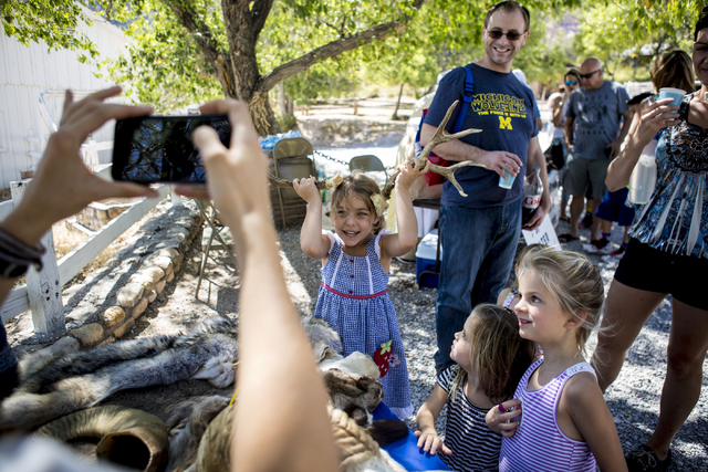 Francesca Feher, 6, puts horns on her head for a photo during Pioneer Day at Spring Mountain Ranch State Park in Las Vegas, Sat, Sept. 17, 2016. Elizabeth Page Brumley/Las Vegas Review-Journal Fol ...