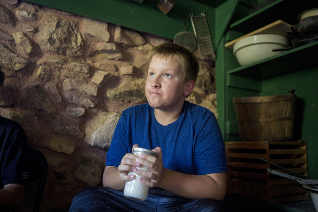 "Brandon Karvonen,11, turns butter, and laughs saying ""it is hard work,"" during Pioneer Day at Spring Mountain Ranch State Park in Las Vegas, Sat, Sept. 17, 2016. Elizabeth Page B ..."