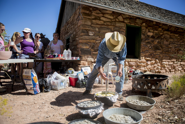 Dutch oven cooked pot pie is scooped for visitors to taste during Pioneer Day at Spring Mountain Ranch State Park in Las Vegas, Sat, Sept. 17, 2016. Elizabeth Page Brumley/Las Vegas Review-Journal ...
